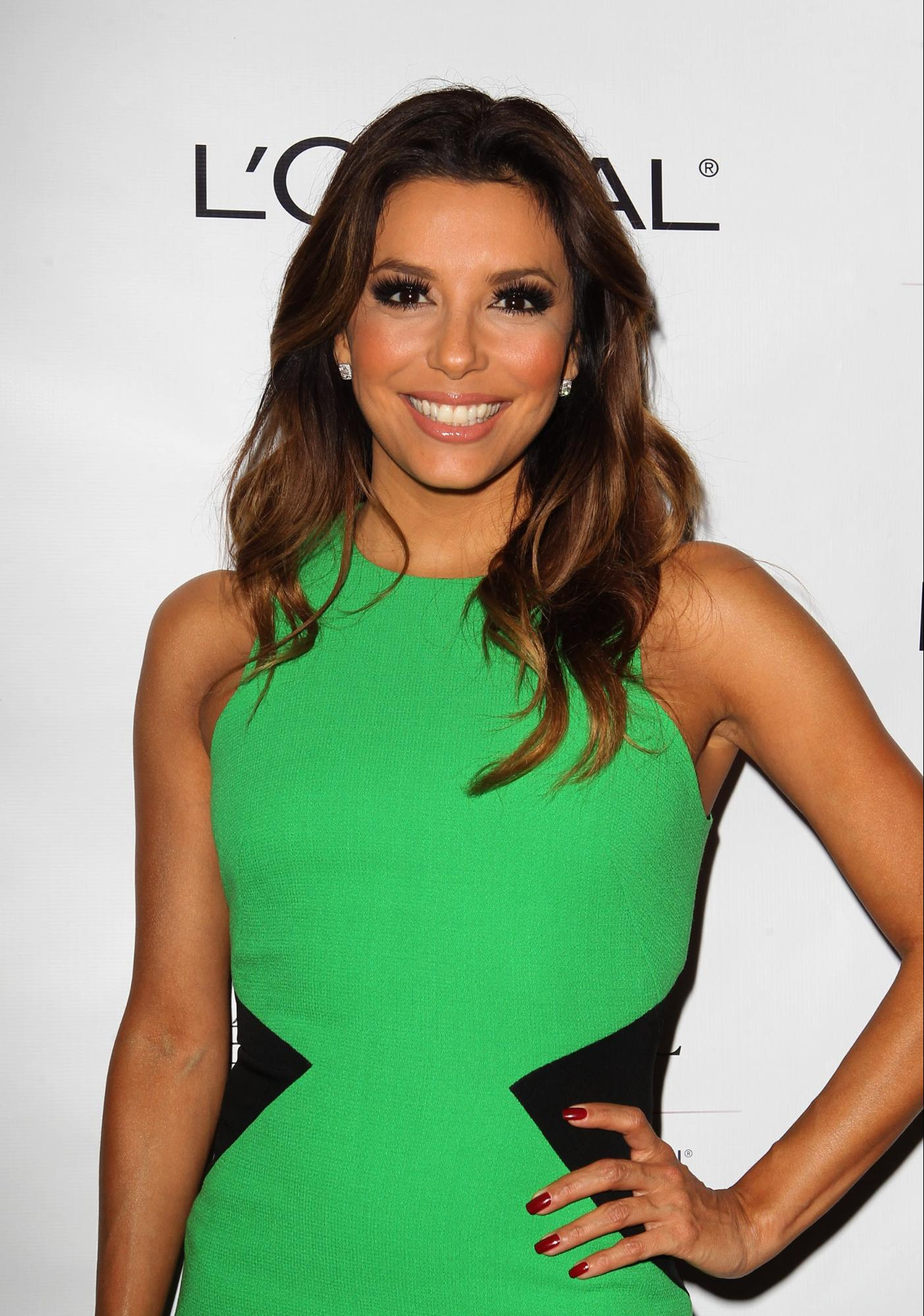 Eva Longoria wore this subtle body contouring dress to enhance her waist and make it appear more nipped in. Credit: WENN